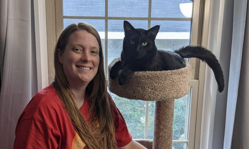 Gabrielle Smyly with one of her cats, Huginn